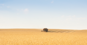Tractor harvesting crops