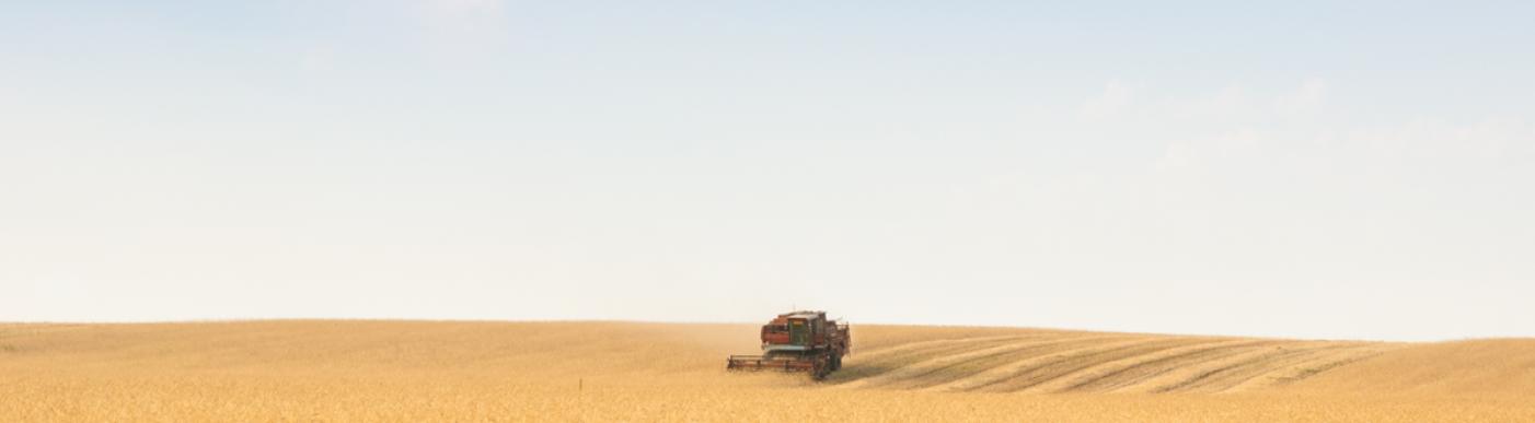 Tractor harvesting crops